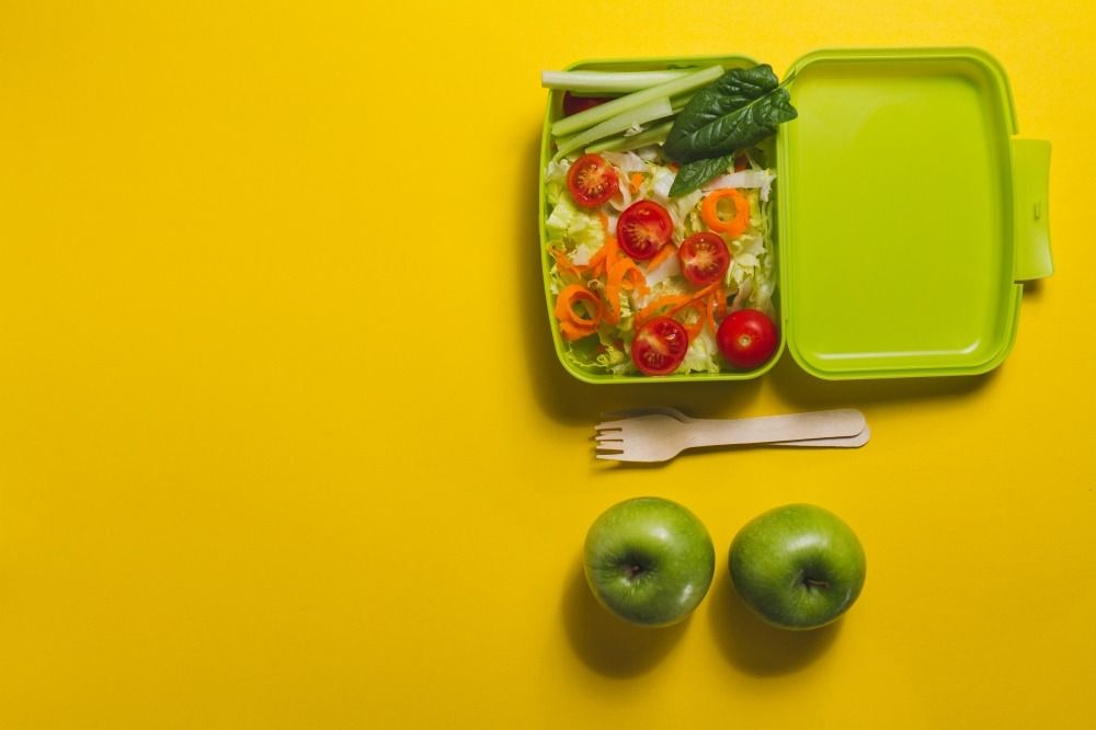 woman thinking her weekly nutritional schedule