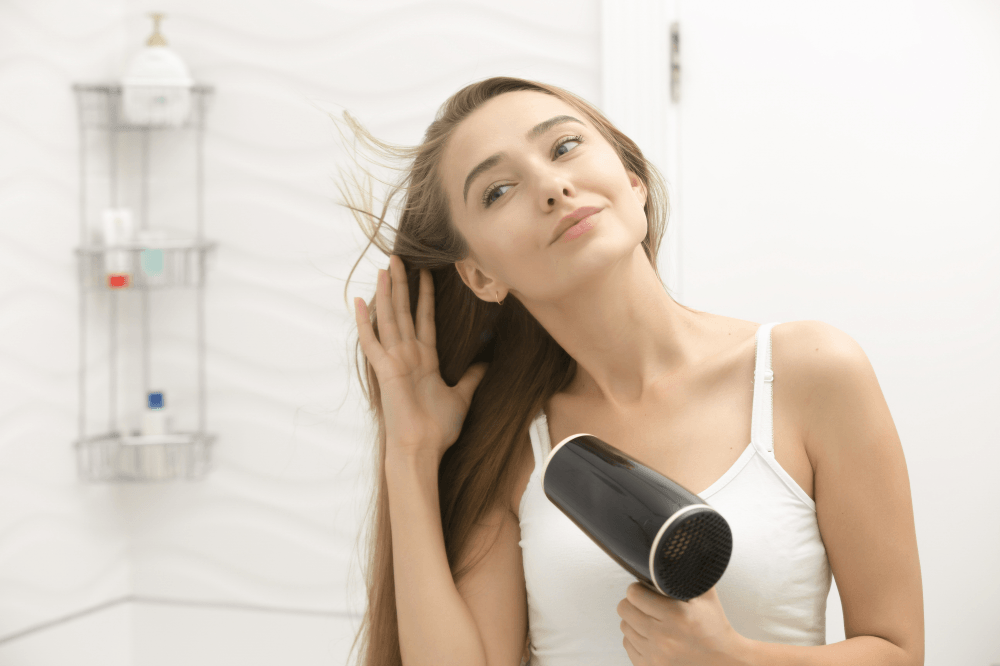 Beautiful Young Woman Taking Care Of Her Hair At Home