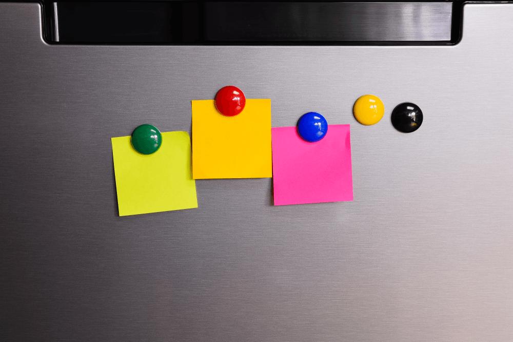 Colorful post it on refrigerator's door