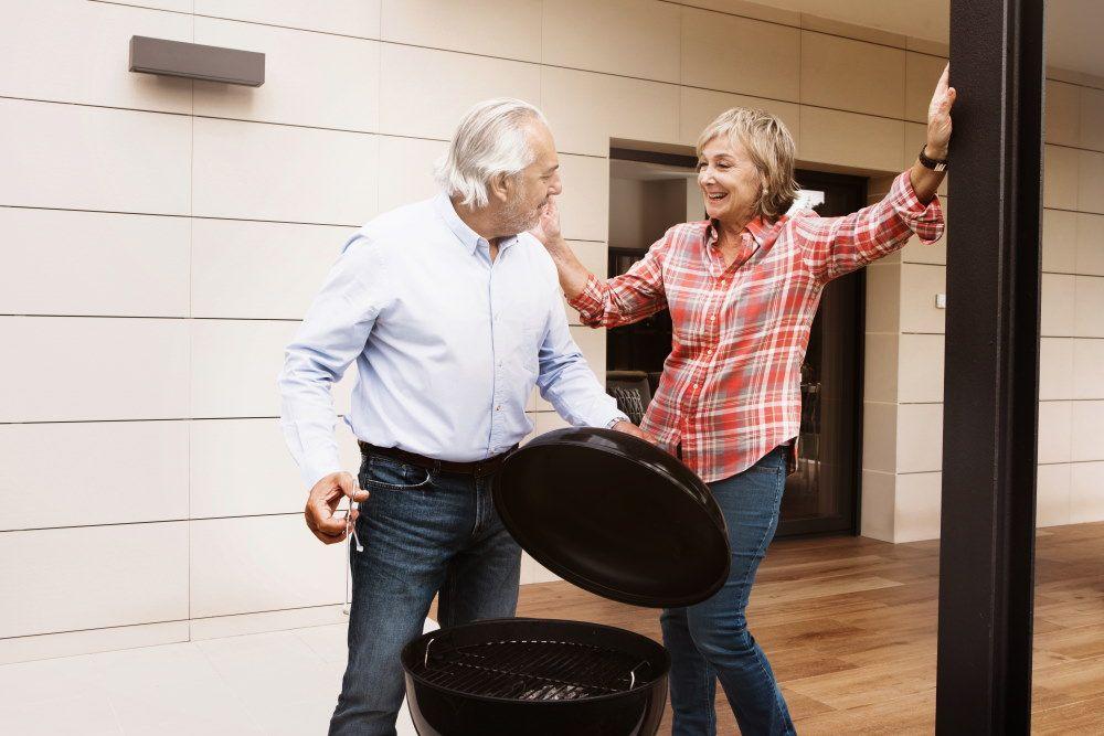 Senior couple prepare bbq