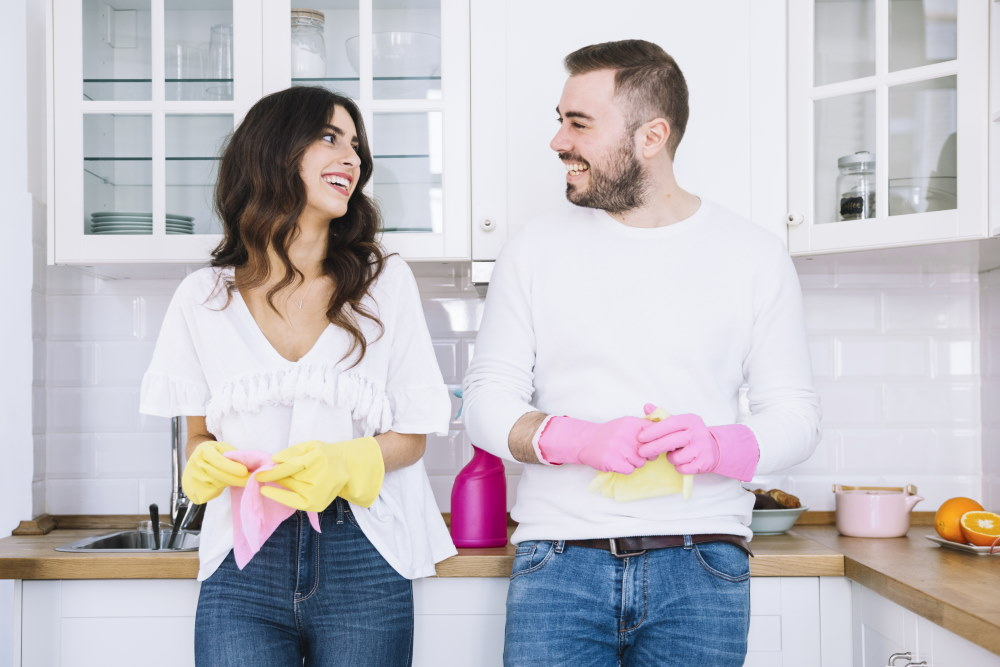 Young Couple Ready To Clean The House
