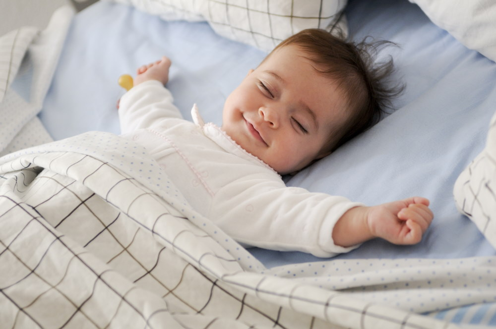 Baby sleeping and smiling