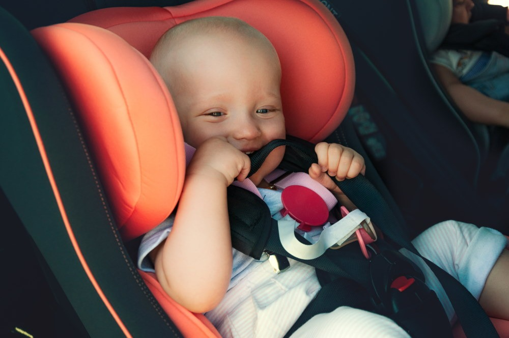 Happy infant on car seat